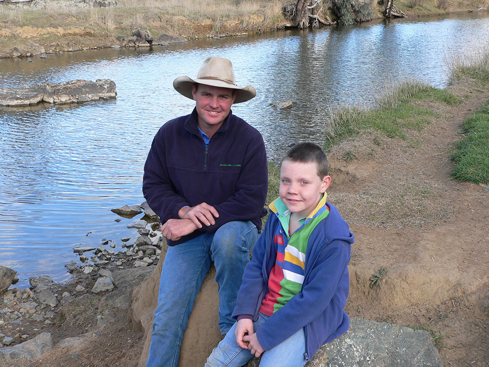 MH Premium Farms manager Allan Munns and his son Fergus on the banks of the Boorowa River at Suffolk Vale, Boorowa, NSW. According to Allan, the company decided to get involved in the Rivers of Carbon project to better manage the environment and improve their production goals.